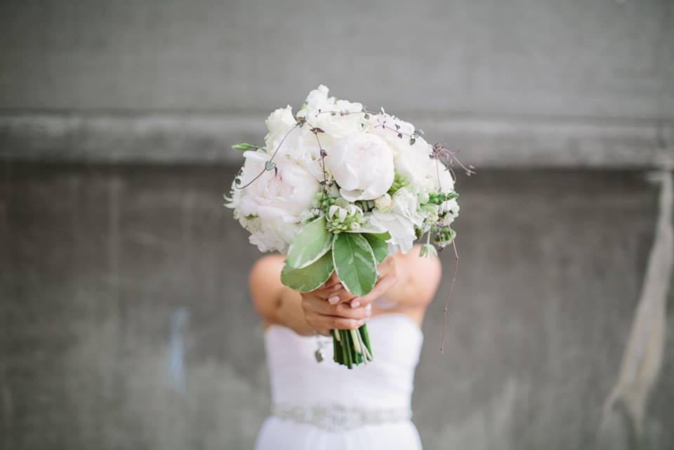 Close up of Rachel's bouquet held in front of her.