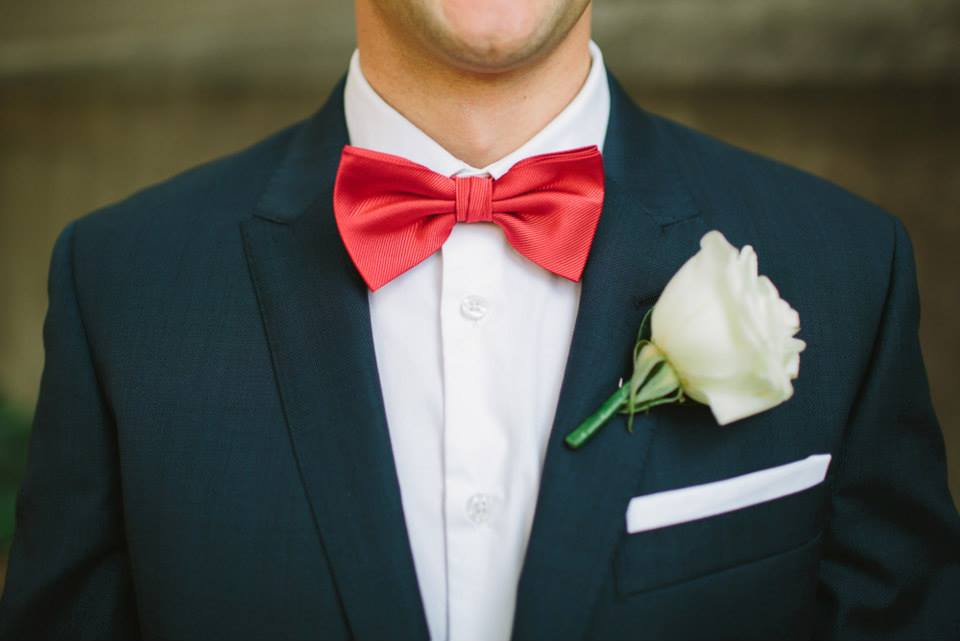 Close up of the groom, Glenn wearing his white rose buttonhole.
