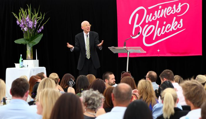 Seth Godin on stage with our floral displays at the Business Chicks lunch